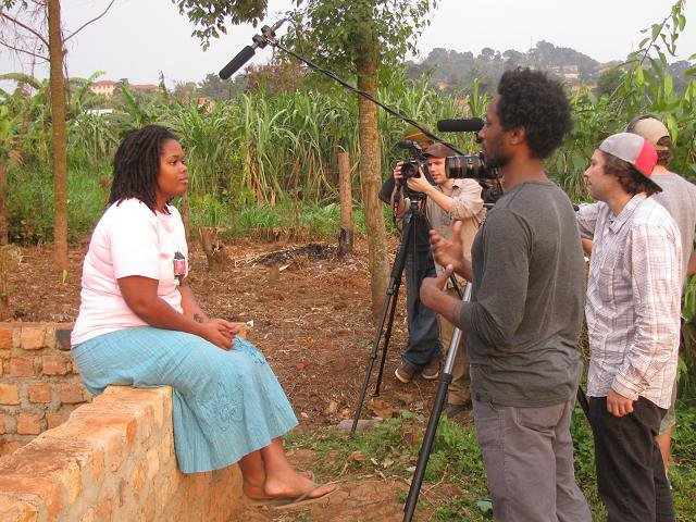Divinity filming with Skinner and his documentary crew in Uganda.